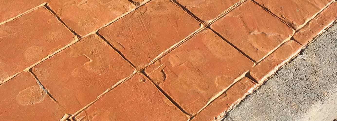 suelo de hormigón impreso simil adoquín anaranjado